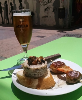 Tapas and a cerveza on a sunny afternoon.